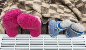 Warming feet on heater